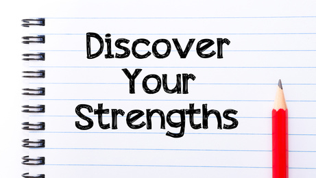 Discover your Strengths Text written on notebook page, red pencil on the right. Motivational Concept image